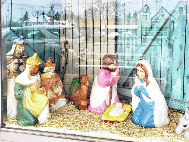 A Nativity scene greets visitors outside My Mother's Memories decor and antique shop.