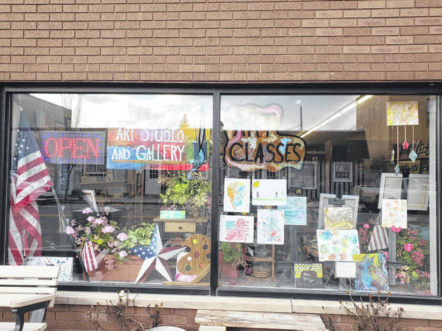 Artwork celebrating MLK Day created by students at Fairborn City Schools on display in the window of Terri Lynn Art Studio and Gallery.
