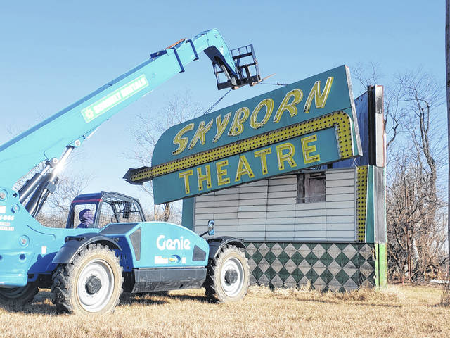 Crews lift the marquee sign off of its foundations near SR 235.