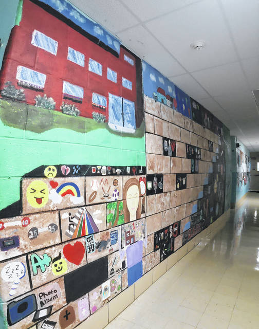 Students at Fairborn Digital Academy have painted many murals on the walls of the former Black Lane Elementary School, where FDA is housed.