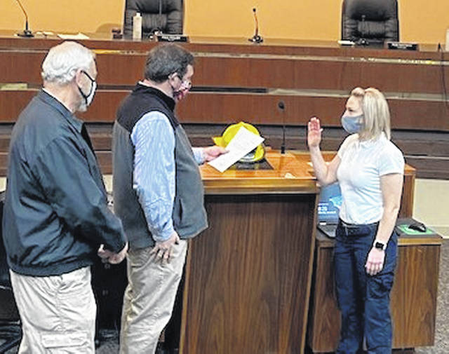 The Fairborn Fire Department recently welcomed two new firefighters to the city. Above: Probationary firefighter Jenna Bennett is sworn in.