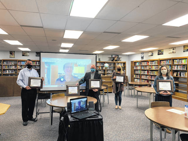 From left to right: school board members Jerry Browning, Andrew Wilson (via Zoom), president Pat McCoart, Mary Reaster, and Katie Mlod.