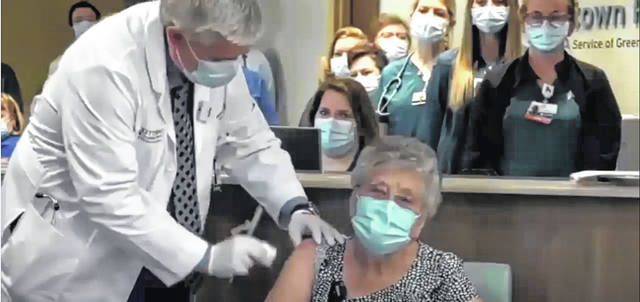 Screenshot courtesy Ohio Channel Iola Creamer, 101, gets ready to receive a COVID-19 vaccination from Dr. Kevin Sharrett in Jamestown Tuesday. Those 80 and over are able to get the vaccine this week. Younger age groups will be added weekly.