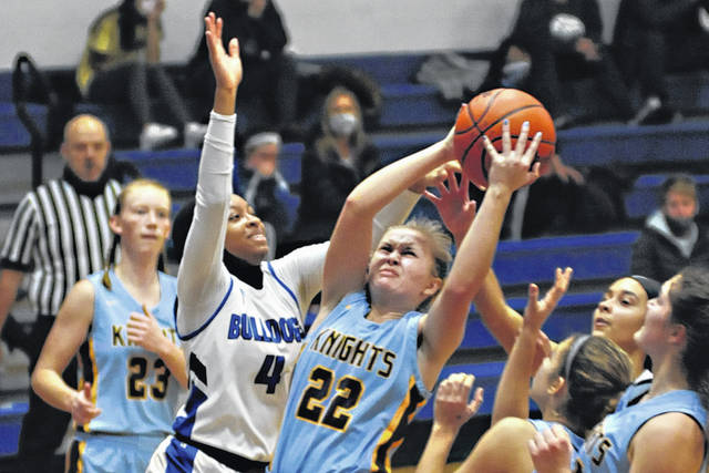 Photos by Charles Caperton | Greene County News Legacy Christian Academy's Katie Leach (22) goes up for two as Yellow Springs' Haneefah Jones defends.