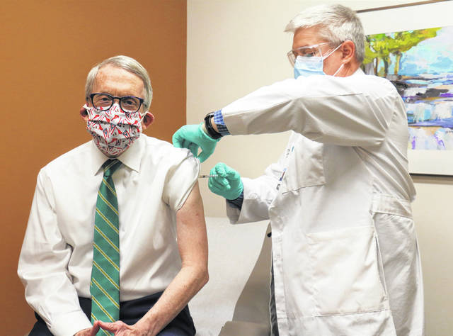 Photos courtesy State of Ohio Gov. Mike DeWine received his second coronavirus vaccine dose Tuesday from Dr. Kevin Sharrett.