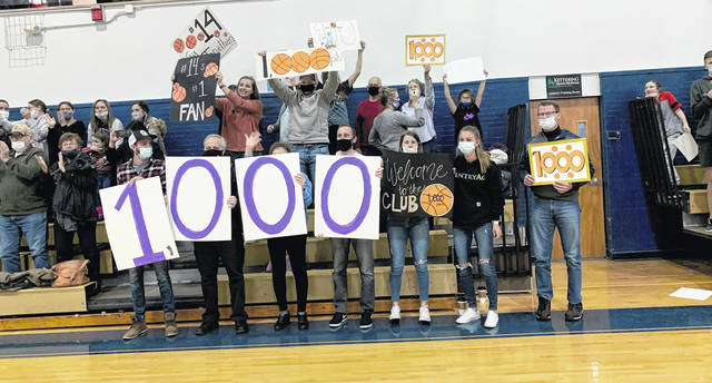 Photos courtesy Legacy Christian Academy Family members react to Jonathan Riddle scoring his 1,000th career point Feb. 12.