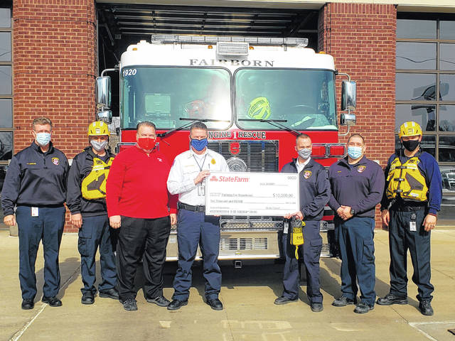Local State Farm agent Jeff Roberts presented a check in the amount of $10,000 to the Fairborn fire department Tuesday.
