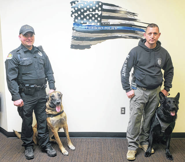 K-9 officers Joe Pence and Rod Myers, with their dogs Bac and Nico.