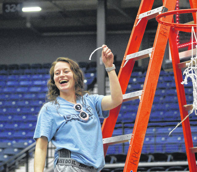 Photo courtesy Mount Vernon Nazarene University Cedarville alumnus Maggie Coe holds a piece of the net after helping Mount Vernon Nazarene University advance to the Sweet 16 of the NAIA national tournament.