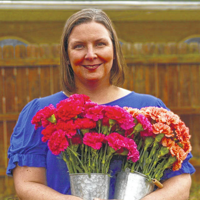 Yellow Springs resident Laura Skidmore will make her flowers into a six feet long, heart-shaped garland to be laid near the village fire station in memory of those who have died of COVID-19.
