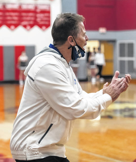 File photo Xenia Coach Anderson cheers during the game against Stebbins on Jan. 27. Xenia won the game, giving Anderson his 300th career win. He announced his resignation as boys coach Monday.
