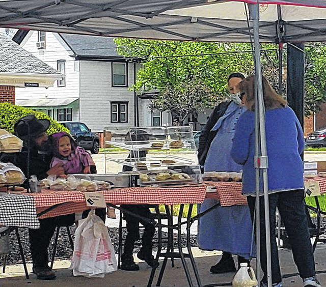 London Bishop | Greene County News Fairborn residents steadily turned out for the first farmer's market of the year despite the windy weather.
