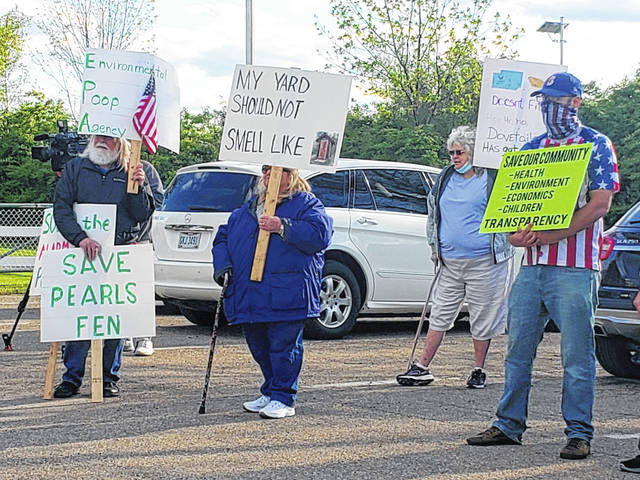London Bishop   Greene County News Protesters outside the Bath Township building prior to the trustee meeting the evening of May 5.