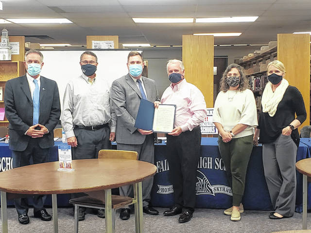 London Bishop | Greene County News Deputy Mayor Rob Hoffman presents Superintendent Gene Lolli and members of the Fairborn Board of Education a proclamation in support of the district's Closing the Learning Gap program.