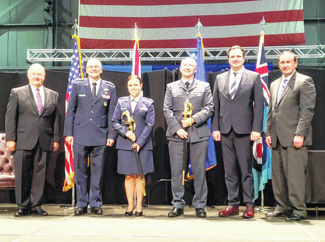 Photos by London Bishop | Greene County News Gen. Arnold Bunch Jr., Commander of USAF Material Command and UK Consul General Alan Gogbashian present Captain Katie Broyles and Group Captain Andrew Lloyd with the 2020 Swords of Honor for their respective Forces.