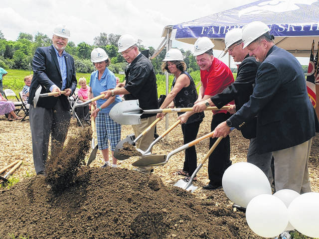 Mayor Paul Keller, members of Fairborn City Council, Greene County commissioners, Bath Township trustees, and the Fairborn Chamber of Commerce break ground at the site of the high school.