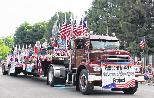 File photo The Military and Veterans Memorial Project truck moves down Central Avenue during Fairborn's July 4 parade in 2019. The 2021 parade kicks off at 2 p.m. Sunday.