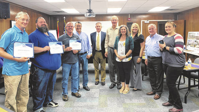 Submitted photo Fairborn digital team members Emily Geisel, Tim Steininger, Mike Morrow, and Rich Hawley with the Fairborn Board of Education, Superintendent Gene Lolli and Treasurer, Kevin Philo.