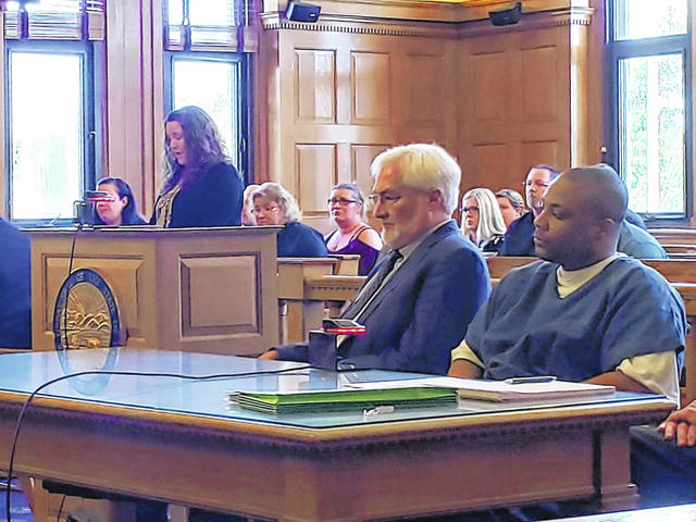 Photo by London Bishop | Greene County News Michael McLendon (right) and his attorney listen to a statement read by Andrew Day's widow (left). McLendon was sentenced Wednesday for Day's shooting death in 2018.