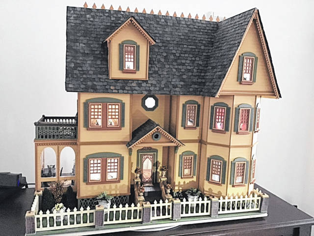 This dollhouse by Linda Adams is at a half-inch scale, meaning every foot is represented by a half-inch, from the construction of the house to the tiny furniture inside.
