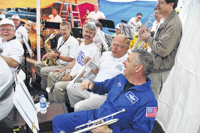 Submitted photos Members of the Fairborn Civic Band laugh with Johnson's brother, NASA pilot Col. Gregory H. Johnson, who stepped down from his float in 2008 to play trumpet with them.
