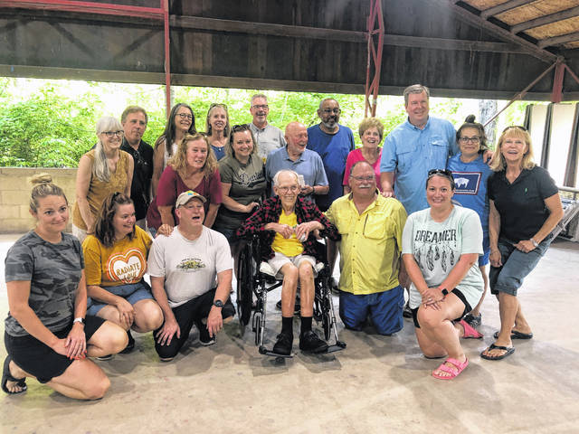 Submitted photos Ray Wylam is surrounded by 22 of his former campers on July 15. The 88-year-old had a wish to go on one more camping trip, after spending decades of his life shaping the lives of young people through adventure and exploration.
