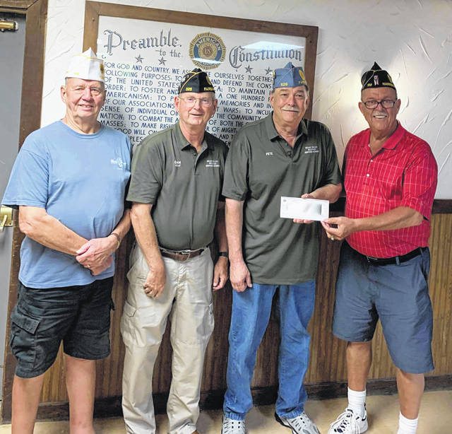 Submitted photo Dan Kirkpatrick and Pete Bales visited Yeager-Benson Memorial American Legion Post 199 in Harrison, Ohio to be presented with a generous donation from the American Legion Department of Ohio Charities, Inc. in support of the Miami Valley Military History Museum's move to Fairborn.