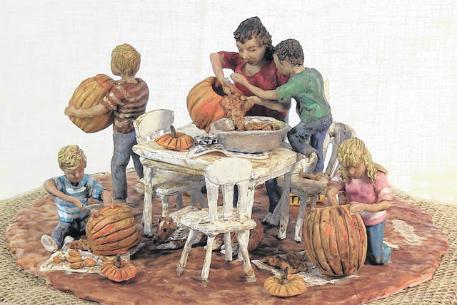 Submitted photos Sharon Mohler, August's featured artist at the Yellow Springs Art Gallery, sculpts dollhouse-sized scenes in clay. Pieces featured here are titled 'Pumpkin Carving,' 'Street Musicians,' and 'You Can't Wait for the Right Time.'