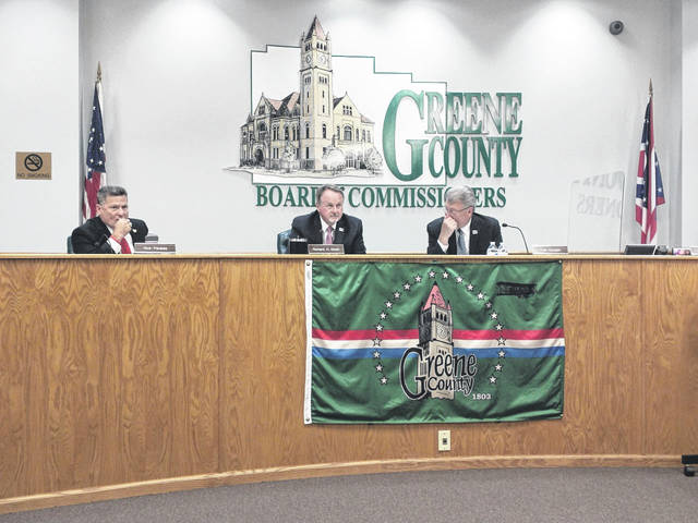 Greene County Commissioners await the beginning of the public hearing.