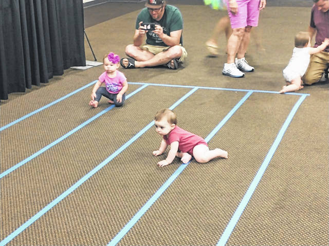 Photos by Darryl McGee | Greene County News It was cuteness overload! Local babies participated in a race at the 2021 Greene County Fair to see who could crawl to their parent first during the annual Diaper Derby Contest. The event was sponsored by Soin Medical Center and gifts were handed out.
