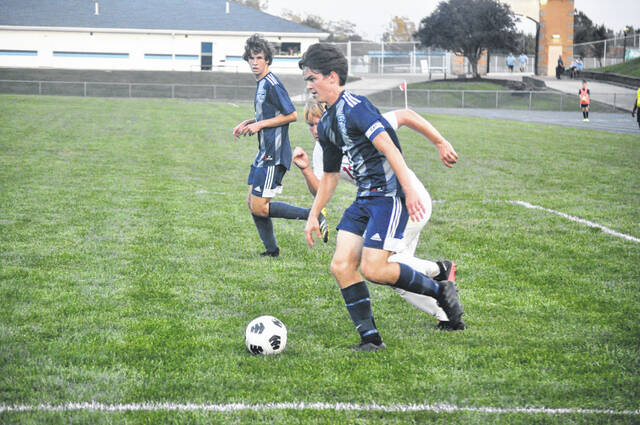 Fairborn senior Donovan Dierker (3) is our mid-season male athlete of the year. He leads the MVL in goals and points this season, scored twice in this match against Troy on Sept. 14, and tied a school record with a six-goal performance against Greenville.
