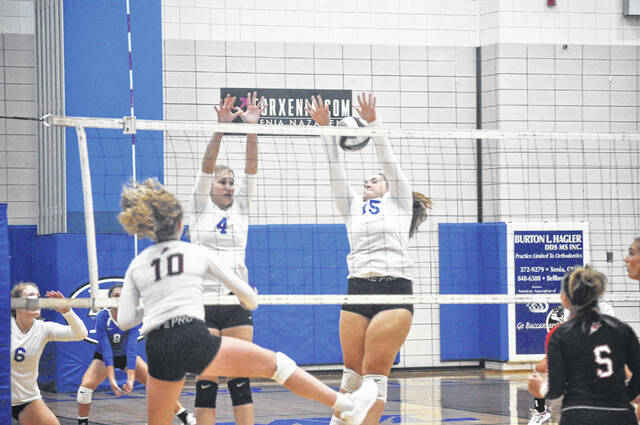 Junior Kendall Sherman (4) and sophomore Kassie Schrack (15) look to block a kill attempt against Tippecanoe on Tuesday. Tippecanoe won the match in straight sets.