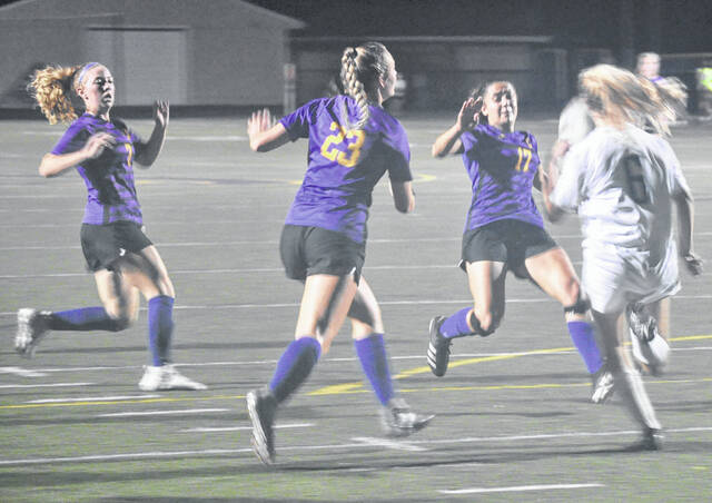 A trio of Bellbrook attackers look to stop a Franklin clearance attempt, including sophomore Lily Schindler (7), senior Kylie Bunker (23) and senior Alyssa Lemos (17).