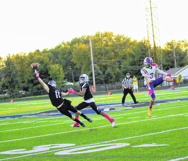 Photos by Barb Slone   Greene County News Xenia's Austin Penewit nearly makes a diving interception early in Friday's game against Butler.
