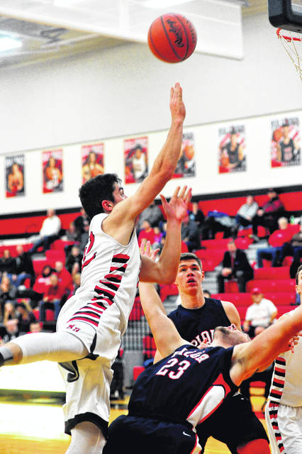 Milton's Daniel Albaught, 32, gets off a shot a draws a foul against the Indians.