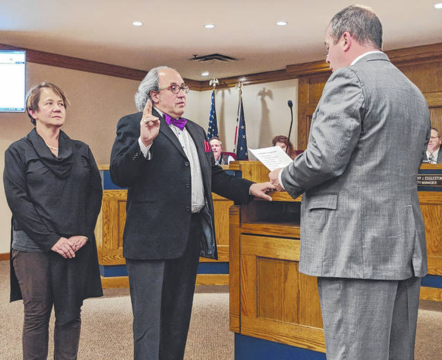 Cecilia Fox | Troy Daily News Frank Scenna was sworn in Tuesday night as Tipp City's newest city council member by Miami County Municipal Court Judge Sam Huffman, supported by his wife, Heather Bailey.