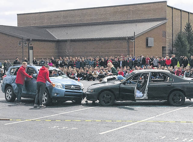 Cody Willoughby | Troy Daily News A spectating student body watches as bystanders try to help the injured before emergency responders arrive during the mock crash staged at Tippecanoe High School on Thursday.