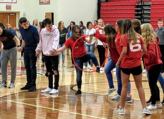 Cecilia Fox | Weekly Record Herald Tippecanoe High School held a pep rally last Friday where each grade competed against each other at various games. The event was held before prom on Saturday. A group of juniors races to pass a hula hoop between their joined hands.