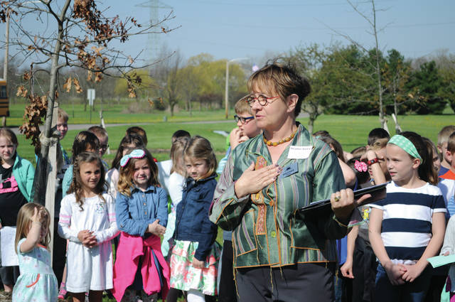 Cecilia Fox | Weekly Record Herald Heather Bailey of the Tipp City Foundation address attendees at a tree grove dedication in celebration of Arbor Day and the foundation's 75th anniversary. Since 1943, the foundation has distributed $2 million to community groups and projects.