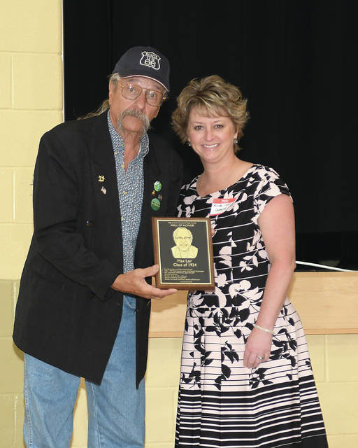 Provided photo Greg Kochersperger presenting the Hall of Honor award to Krista Carpenter, Max Lair's granddaughter