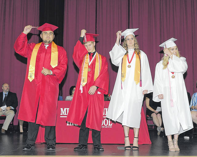 Expressions Studios Kyler Schatz, Matthew Brown, Madison Hoffman, Kiley Jacobe celebrate during the Milton-Union High School commencement ceremony May 25.