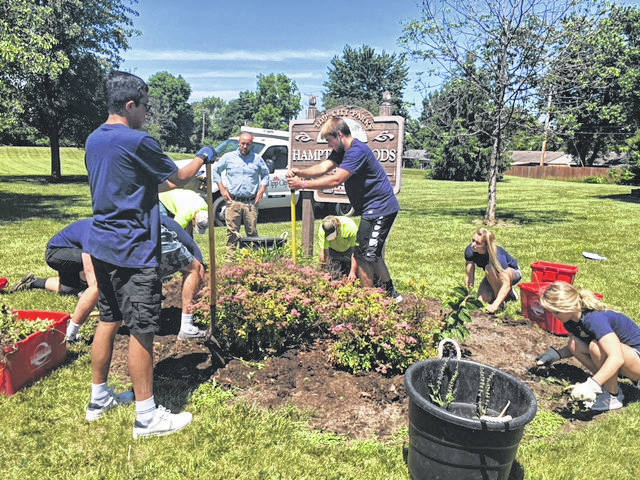 Provided photo The first Teen Leadership Academy class spent a week learning about the Tipp City and Bethel communities and completing community service projects. At Hampton Woods Park in Tipp City, the students did some landscaping work.