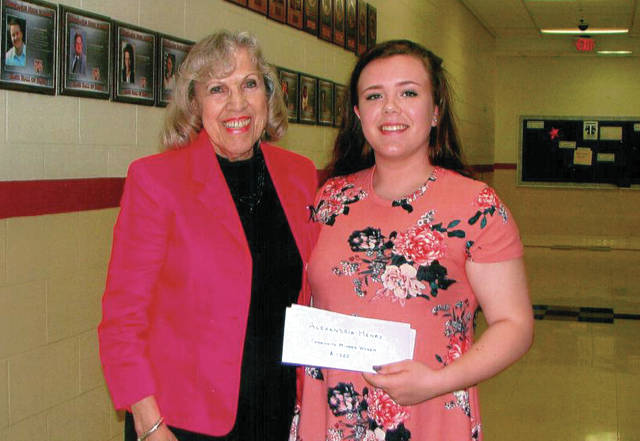 Provided photo Lolita Border, CMW scholarship committee chair, awards the club's annual scholarship to THS graduate Alexandria Henry, who will be attending the University of Cincinnati in the fall.
