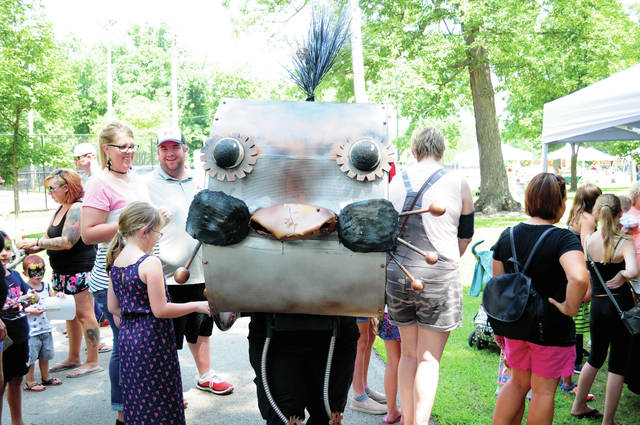 Cecilia Fox | Weekly Record Herald A puppeteer from the Soot Theatre Company in a wearable puppet delighted crowds during the Art in the Park and Children's Art Adventure last weekend. Zoot is a theatrical design company, specializing in puppets and masks.