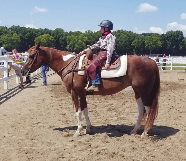 Provided photo Brent Hartzell, 10, of Houston riding Tater, and a member of the Covington Mounties won first place in Ranch Pleasure 9-13. The parents are Brandon and Katie Hartzell. Brent Hartzell (10 yrs old) and Tater placing 2nd in 9-13 Western Horsemanship. Houston, ohio. 4h group is covington mounties parents Brandon and Katie Hartzell