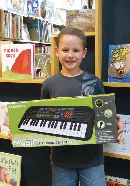 Provided photo Maggie Klepinger was the winner of a keyboard following this year's Milton-Union Public Library summer reading program. Each winner completed the entire bingo board for their grade level. Winner's names were drawn for the grand prize for their grade level.