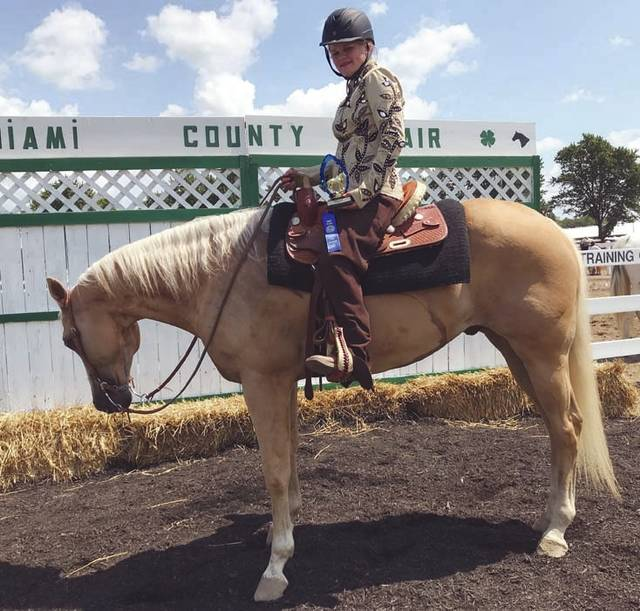 Melody Vallieu | AIM Media Midwest Whitley Slaton, 12, of Tipp City and a member of the Lucky Horse Shoes 4-H Club, won first place 3-Gait Novice with her horse Johnny. She is the daughter of Maria and Mark Fox and Bobby Slaton.