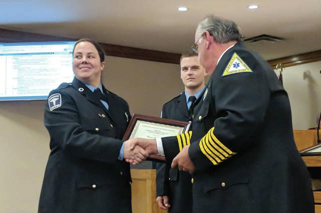 Cecilia Fox | Weekly Record Herald EMT Megan Holfinger accepting her award from EMS Chief Jeff Calicoat last week.