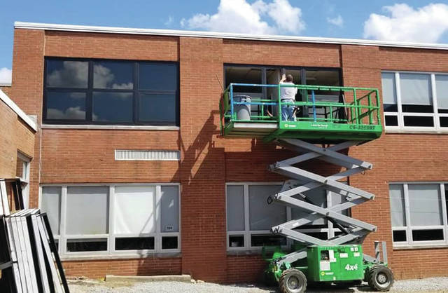 Provided photo New, more energy-efficient windows are being installed at the middle school as part of the district's summer renovation work, which has been funded by permanent improvement levy money.