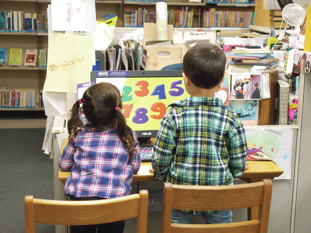 Provided photo West Milton siblings Owen and Stella Knostman had a great time interacting with the AWE computer in the children's department at the Milton-Union Public Library on Tuesday, Sept. 25. This early literacy and learning computer system is just one of the engaging items in the library that can be used to spark a love for reading. Weekly programs like Tiny Tots, Story Hour and Buddy Reading are offered to enrich the lives of children and their caregivers. Call the library at 698-5515 or visit www.mupubliclibrary.org for the calendar of events for the whole family.